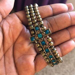 Jewelry - Gold and blue cross bracelet